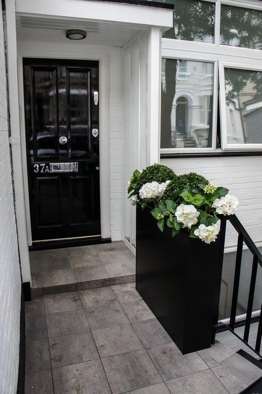 Contemporary planters outdoor planters designer for Narrow front door