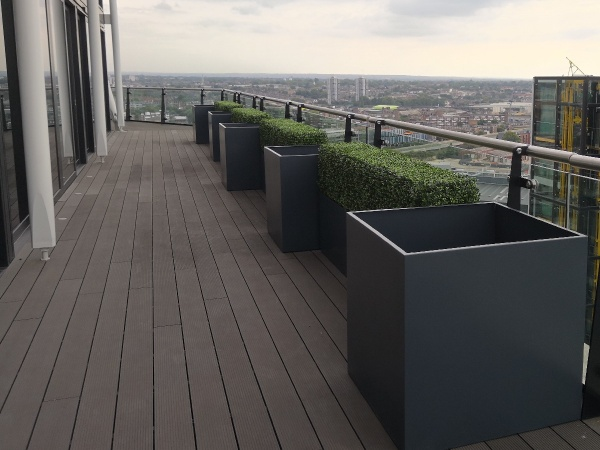 Bespoke metal planters on a roof terrace